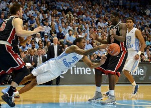 Dec 29, 2012 Chapel Hill, NC, USA. North Carolina Tar Heels guard Leslie McDonald (2) dives for a loose ball between UNLV Runnin