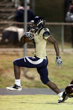 Oct 21, 2011; Charlotte, NC, USA; Mallard Creek Mavericks wide receiver Marquez North (8) runs the ball in for a touchdown during the second quarter against the West Charlotte Lions. The Mavericks defeated the Lions 42-0. Mandatory Credit: Jeremy Brevard-USA TODAY Sports