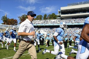 Nov 10, 2012; Chapel Hill, NC, USA; North Carolina Tar Heels head coach Larry Fedora runs on to the field before the game at Kenan Stadium. Mandatory Credit: Bob Donnan-USA TODAY Sports