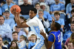 Dec 22, 2012; Chapel Hill, NC, USA; North Carolina Tar Heels guard Dexter Strickland (1) grabs a rebound as McNeese State Cowboys guard Kevin Hardy (11) defends. The Tar Heels defeated McNeese State 97-63 at the Dean E Smith Center. Mandatory Credit: Bob Donnan-USA TODAY Sports