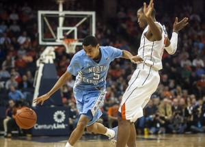 Jan 6, 2013; Charlottesville, VA, USA; North Carolina Tar Heels guard Marcus Paige (5) handles the ball around Virginia Cavaliers forward Akil Mitchell (25) during the second half at John Paul Jones Arena. Mandatory Credit: Peter Casey-USA TODAY Sports