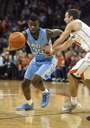 Jan 6, 2013; Charlottesville, VA, USA; North Carolina Tar Heels guard/forward Reggie Bullock (35) looses control of the ball while guarded by Virginia Cavaliers forward Evan Nolte (11) during the second half at John Paul Jones Arena. Mandatory Credit: Peter Casey-USA TODAY Sports