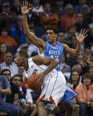 Jan 6, 2013; Charlottesville, VA, USA; Virginia Cavaliers forward Darion Atkins (32) drives to the basket against North Carolina Tar Heels forward James Michael McAdoo (43) during the second half at John Paul Jones Arena. Mandatory Credit: Peter Casey-USA TODAY Sports