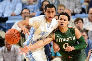 Jan 10, 2013; Chapel Hill, NC, USA; Miami (Fl) Hurricanes guard Shane Larkin (0) knocks the ball away from North Carolina Tar Heels guard Marcus Paige (5) in the first half at the Dean E. Smith Center. Mandatory Credit: Bob Donnan-USA TODAY Sports
