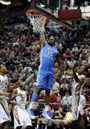 Jan 12, 2013; Tallahassee, FL, USA; North Carolina Tar Heels guard Pj Hairston (15) dunks the ball past Florida State Seminoles guard Michael Snaer (21) and forward Terrance Shannon (2) during the game against the Florida State Seminoles at the Donald L. Tucker Center.  Mandatory Credit: Melina Vastola-USA TODAY Sports
