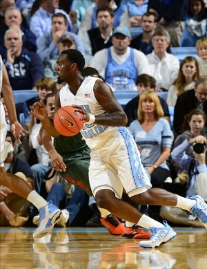 Jan 10, 2013; Chapel Hill, NC, USA; North Carolina Tar Heels guard P.J. Hairston (15) dribbles in the first half. The Hurricanes defeated the Tar Heels 68-59 at the Dean E. Smith Center. Mandatory Credit: Bob Donnan-USA TODAY Sports