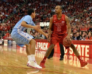 Jan 26, 2013; Raleigh, NC, USA; North Carolina State Wolfpack guard Lorenzo Brown (2) dribbles as North Carolina Tar Heels guard Marcus Paige (5) defends during the first half at PNC Arena. Mandatory Credit: Rob Kinnan-USA TODAY Sports