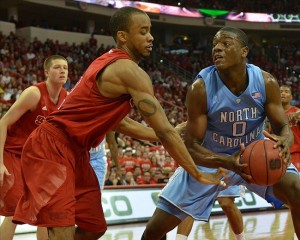 Jan 26, 2013; Raleigh, NC, USA; North Carolina State Wolfpack guard Lorenzo Brown (2) attempts to steal the ball from North Carolina Tar Heels forward Joel James (0) during the second half at PNC Arena. North Carolina State won 91-83. Mandatory Credit: Rob Kinnan-USA TODAY Sports