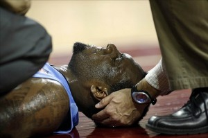 Jan 29, 2013; Chestnut Hill, Massachusetts, USA; A trainer holds the neck of North Carolina Tar Heels guard P.J. Hairston (15) after he was injured during the first half against the Boston College Eagles at Conte Forum. Mandatory Credit: Greg M. Cooper-USA TODAY Sports