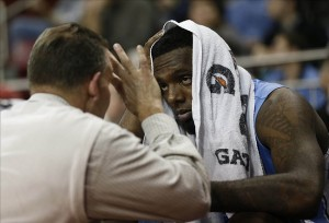 Jan 29, 2013; Chestnut Hill, Massachusetts, USA; North Carolina Tar Heels guard P.J. Hairston (15) talks with trainer Chris Hirth after returning to the bench during the second half against the Boston College Eagles at Conte Forum. The North Carolina Tar Heels won 82-70. Mandatory Credit: Greg M. Cooper-USA TODAY Sports