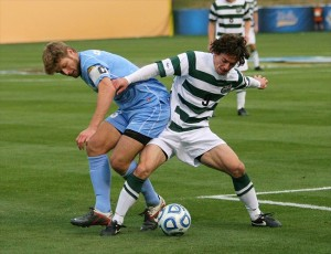Dec 11, 2011; Hoover, AL, USA; North Carolina Tar Heels midfielder Kirk Urso (3) struggles for the ball along with UNC Charlotte 49ers defender Thomas Allen (5) during the NCAA Soccer Championship at Regions Park. The Tar Heels defeated the 49ers 1-0 to win the championship. Mandatory Credit: Marvin Gentry-USA TODAY Sports