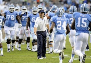 Sep 29, 2012; Chapel Hill, NC, USA; North Carolina Tar Heels coach Larry Fedora congratulates his team on a good play against the Idaho Vandals in the first half at Kenan Memorial Stadium. Mandatory Credit: Liz Condo-USA TODAY Sports