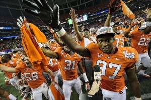 Dec 31, 2012; Atlanta, GA, USA; Members of the Clemson Tigers celebrate after defeating the LSU Tigers in the 2012 Chick-fil-A Bowl at the Georgia Dome. Clemson won 25-24. Mandatory Credit: Paul Abell-USA TODAY Sports