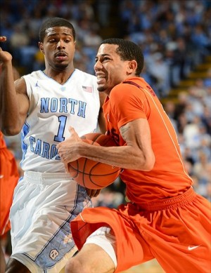 Feb 2, 2013; Chapel Hill, NC, USA; Virginia Tech Hokies guard Erick Green (11) drives as North Carolina Tar Heels guard Dexter Strickland (1) defends in the first half at the Dean E. Smith Center. Mandatory Credit: Bob Donnan-USA TODAY Sports