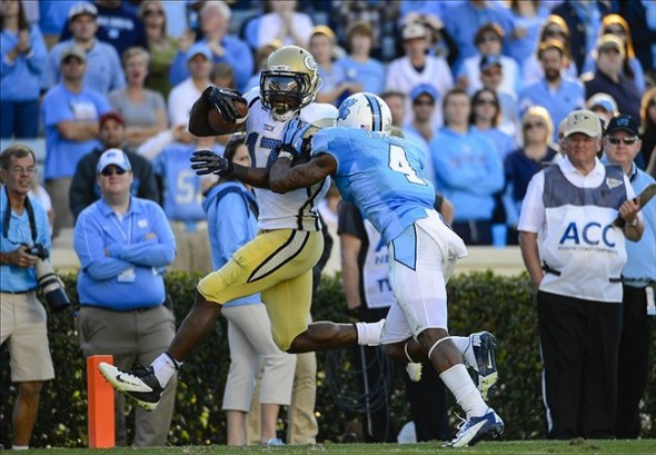Nov 10, 2012; Chapel Hill, NC, USA; Georgia Tech Yellow Jackets running back Orwin Smith (17) runs for a touchdown as North Carolina Tar Heels cornerback Jabari Price (4) defends in the second half. The Yellow Jackets defeated the Tar Heels 68-50 at Kenan Stadium. Mandatory Credit: Bob Donnan-USA TODAY Sports