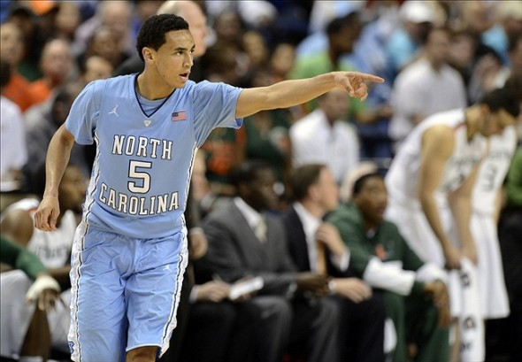 Mar 17, 2013; Greensboro, NC, USA; North Carolina Tar Heels guard Marcus Paige (5) reacts after sinking a 3 pointer against the Miami Hurricanes during the championship game of the ACC tournament at Greensboro Coliseum. Mandatory Credit: John David Mercer-USA TODAY Sports