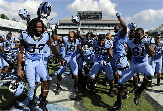 Sep 7, 2013; Chapel Hill, NC, USA; North Carolina Tar Heels corner back T.J. Jiles (37), safety Tre Boston (10), tight end Eric Ebron (85) and wide receiver Kendrick Singleton (81) celebrate their win over the Middle Tennessee Blue Raiders at Kenan Memorial Stadium. North Carolina won 40-20. Mandatory Credit: Liz Condo-USA TODAY Sports