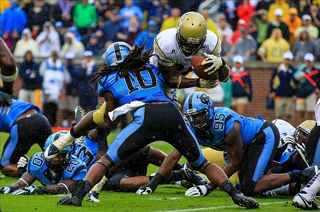 Sep 21, 2013; Atlanta, GA, USA; Georgia Tech Yellow Jackets running back David Sims (20) moves past North Carolina Tar Heels safety Tre Boston (10) for a touchdown in the first half at Bobby Dodd Stadium. Mandatory Credit: Daniel Shirey-USA TODAY Sports