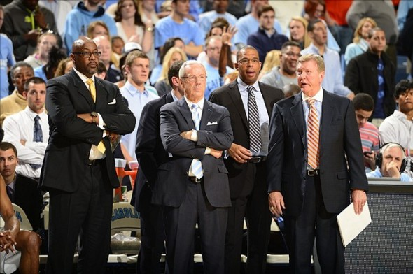 Feb 2, 2013; Chapel Hill, NC, USA; North Carolina Tar Heels coaches Steve Robinson, head coach Roy Williams, Hubert Davis, and Joe Holladay react in the second half. The Tar Heels defeated the Hokies 72-60 at the Dean E. Smith Center. Mandatory Credit: Bob Donnan-USA TODAY Sports