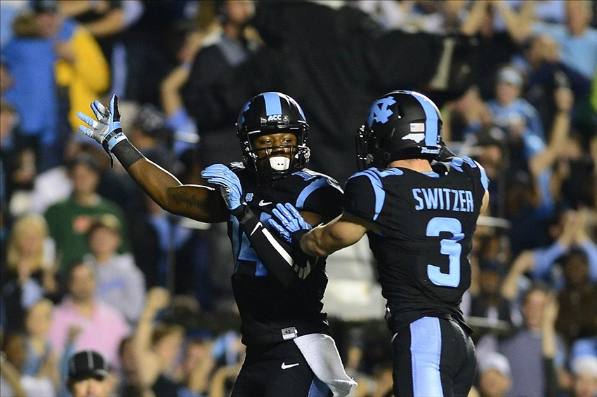 Oct 17, 2013; Chapel Hill, NC, USA; North Carolina Tar Heels wide receiver Quinshad Davis (14) celebrates with wide receiver Ryan Switzer (3) after a touchdown catch in the second quarter at Kenan Memorial Stadium. Mandatory Credit: Bob Donnan-USA TODAY Sports