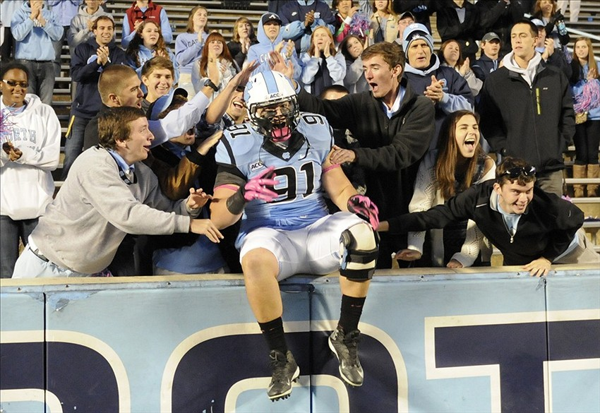 Oct 26, 2013; Chapel Hill, NC, USA; North Carolina Tar Heels defensive lineman Allen Champagne (91) celebrates with fans after their win over the Boston College Eagles at Kenan Memorial Stadium. North Carolina won 34-10. Mandatory Credit: Liz Condo-USA TODAY Sports