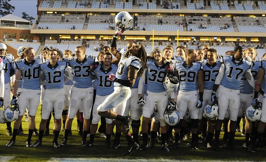 Oct 26, 2013; Chapel Hill, NC, USA; North Carolina Tar Heels safety Tre Boston (10) celebrates with his team after their win over the Boston College Eagles at Kenan Memorial Stadium. North Carolina won 34-10. Mandatory Credit: Liz Condo-USA TODAY Sports