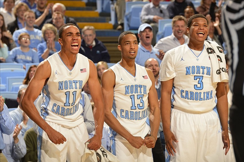 Nov 8, 2013; Chapel Hill, NC, USA; North Carolina Tar Heels forwards Brice Johnson (11) and J.P. Tokoto (13) and Kennedy Meeks (3) celebrate in the second half. The Tar Heels defeated the Oakland Golden Grizzlies 84-61 at Dean E. Smith Student Activities Center. Mandatory Credit: Bob Donnan-USA TODAY Sports