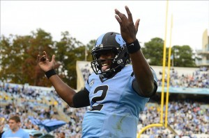 Nov 9, 2013; Chapel Hill, NC, USA; North Carolina Tar Heels quarterback Marquise Williams (2) celebrates after running back Khris Francis (1) scores a touchdown in the fourth quarter. The Tar Heels defeated the Cavaliers 45-14 at Kenan Memorial Stadium. Mandatory Credit: Bob Donnan-USA TODAY Sports