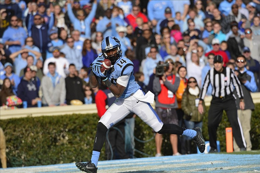 Nov 30, 2013; Chapel Hill, NC, USA; North Carolina Tar Heels wide receiver Quinshad Davis (14) catches a touchdown in the third quarter. The Duke Blue Devils defeated the North Carolina Tar Heels 27-25 at Kenan Memorial Stadium. Mandatory Credit: Bob Donnan-USA TODAY Sports