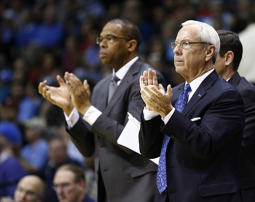 Nov 24, 2013; Uncasville, CT, USA; North Carolina Tar Heels head coach Roy Williams cheers during the first half of a game against the Louisville Cardinals at Mohegan Sun Arena. Mandatory Credit: Mark L. Baer-USA TODAY Sports