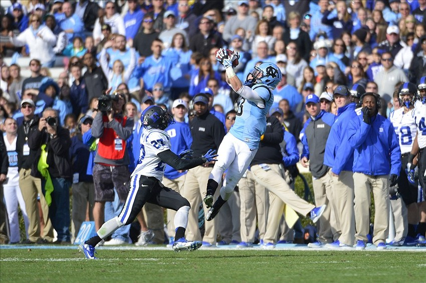Nov 30, 2013; Chapel Hill, NC, USA; North Carolina Tar Heels wide receiver Ryan Switzer (3) catches the ball as Duke Blue Devils cornerback DeVon Edwards (27) defends in the first quarter at Kenan Memorial Stadium. Mandatory Credit: Bob Donnan-USA TODAY Sports