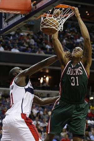 Dec 6, 2013; Washington, DC, USA; Milwaukee Bucks power forward John Henson (31) dunks the ball over Washington Wizards small forward Chris Singleton (31) in the fourth quarter at Verizon Center. The Bucks won 109-105 in overtime. Mandatory Credit: Geoff Burke-USA TODAY Sports