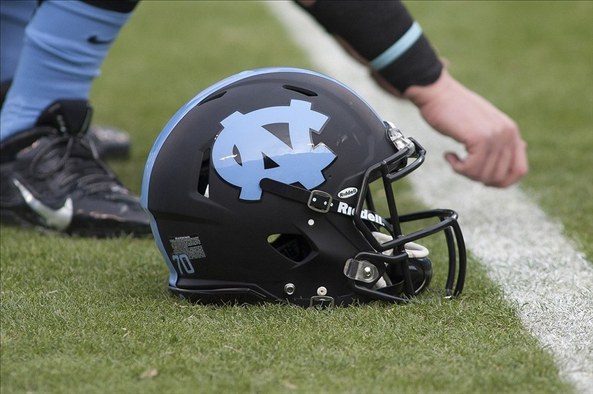 Dec 28, 2013; Charlotte, NC, USA; A North Carolina Tar Heels helmet lays on the field prior to the start of the game against the Cincinnati Bearcats in the Belk Bowl at Bank of America Stadium. Mandatory Credit: Jeremy Brevard-USA TODAY Sports