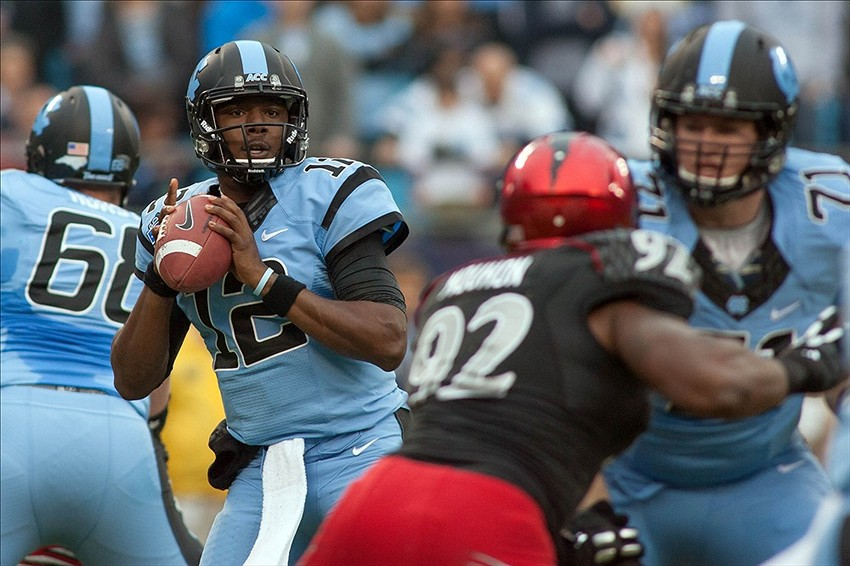 Dec 28, 2013; Charlotte, NC, USA; North Carolina Tar Heels quarterback Marquise Williams (12) looks to pass the ball during the first quarter against the Cincinnati Bearcats at Bank of America Stadium. Mandatory Credit: Jeremy Brevard-USA TODAY Sports