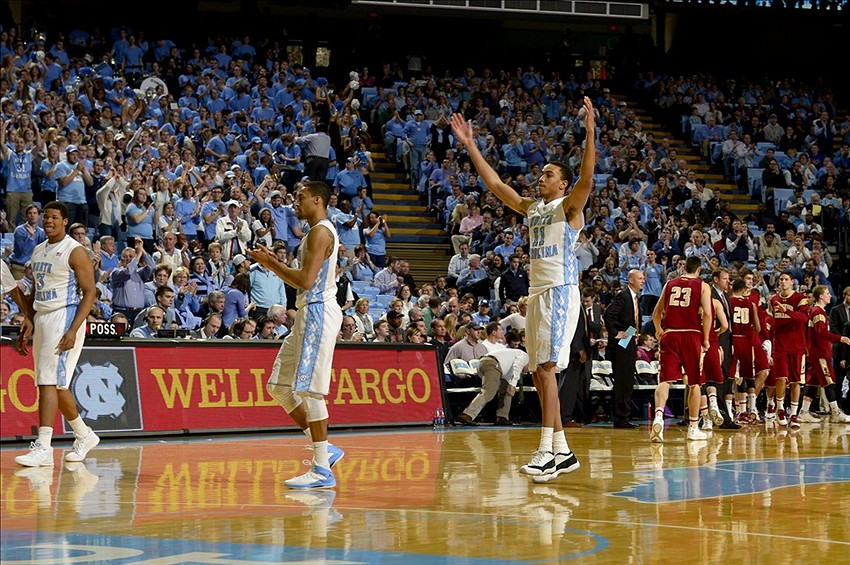 Jan 18, 2014; Chapel Hill, NC, USA; North Carolina Tar Heels forward Kennedy Meeks (3) and forward J.P. Tokoto (13) ad forward Brice Johnson (11) react in the first half at Dean E. Smith Student Activities Center. Mandatory Credit: Bob Donnan-USA TODAY Sports