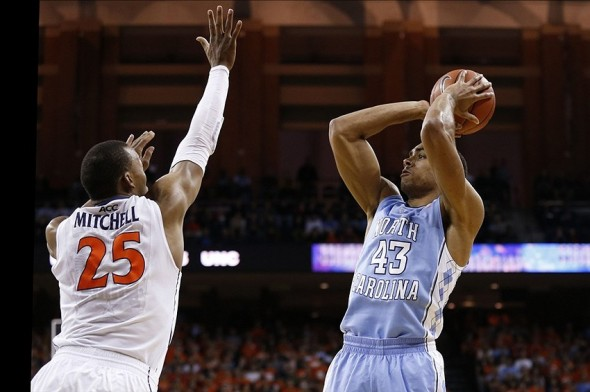 Jan 20, 2014; Charlottesville, VA, USA; North Carolina Tar Heels forward James Michael McAdoo (43) shoots the ball over Virginia Cavaliers forward Akil Mitchell (25) in the first half at John Paul Jones Arena. Mandatory Credit: Geoff Burke-USA TODAY Sports