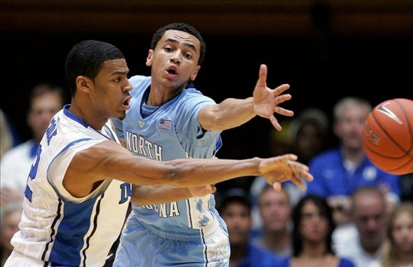 Feb 13, 2013; Durham, NC, USA; North Carolina Tar Heels guard Marcus Paige (5) defends as Duke Blue Devils guard Quinn Cook (2) passes the ball during the first half at Cameron Indoor Stadium. Mandatory Credit: Mark Dolejs-USA TODAY Sports