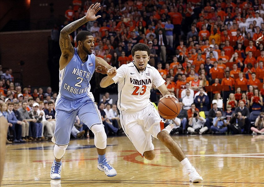 Jan 20, 2014; Charlottesville, VA, USA; Virginia Cavaliers guard London Perrantes (23) dribbles the ball as North Carolina Tar Heels guard Leslie McDonald (2) defends in the second half at John Paul Jones Arena. The Cavaliers won 76-61. Mandatory Credit: Geoff Burke-USA TODAY Sports
