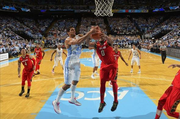 Feb 4, 2014; Chapel Hill, NC, USA; North Carolina Tar Heels forward James Michael McAdoo (43) and Maryland Terrapins forward Charles Mitchell (0) fight for the ball in the first half at Dean E. Smith Student Activities Center. Mandatory Credit: Bob Donnan-USA TODAY Sports