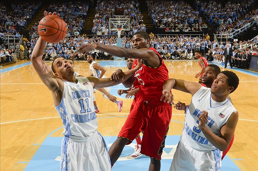 Feb 4, 2014; Chapel Hill, NC, USA; North Carolina Tar Heels forward Brice Johnson (11) grabs a rebound as forward Kennedy Meeks (3) looks on and Maryland Terrapins forward Jonathan Graham (25) defends in the second half. The North Carolina Tar Heels defeated the Maryland Terrapins 75-63 at Dean E. Smith Student Activities Center. Mandatory Credit: Bob Donnan-USA TODAY Sports