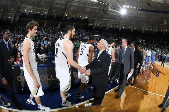 Feb 8, 2014; South Bend, IN, USA; North Carolina Tar Heels coach Roy Williams shakes hands after the game with Notre Dame Fighting Irish center Garrick Sherman (11) at the Joyce Center. Mandatory Credit: Brian Spurlock-USA TODAY Sports