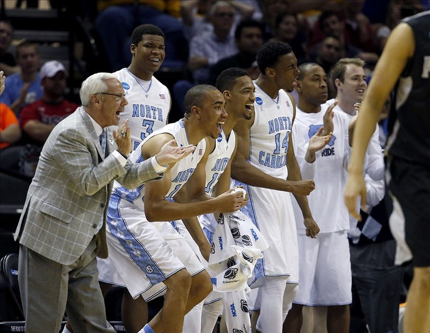Mar 21, 2014; San Antonio, TX, USA; North Carolina Tar Heels head coach Roy Williams and the North Carolina bench reacts in the first half of a men