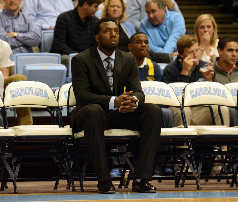 Dec 18, 2013; Chapel Hill, NC, USA; Suspended North Carolina Tar Heels guard P.J. Hairston (center) watches his team warm up prior to the second half against the Texas Longhorns at the Dean E. Smith Student Activities Center. Texas won 86-83. Mandatory Credit: Rob Kinnan-USA TODAY Sports