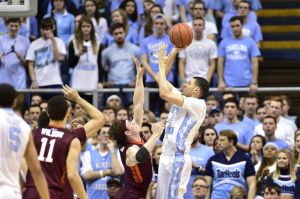 Jan 18, 2015; Chapel Hill, NC, USA; North Carolina Tar Heels guard/forward Justin Jackson (44) shoots as Virginia Tech Hokies guard Devin Wilson (11) and guard Will Johnston (25) defend in the second half. The Tar Heels defeated the Hokies 68-53 at Dean E. Smith Center. Mandatory Credit: Bob Donnan-USA TODAY Sports