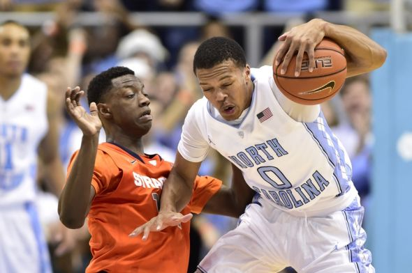 Jan 26, 2015; Chapel Hill, NC, USA; Syracuse Orange guard Kaleb Joseph (14) and North Carolina Tar Heels guard Nate Britt (0) fight for the ball in the second half. The Tar Heels defeated the Orange 93-83 at Dean E. Smith Center. Mandatory Credit: Bob Donnan-USA TODAY Sports