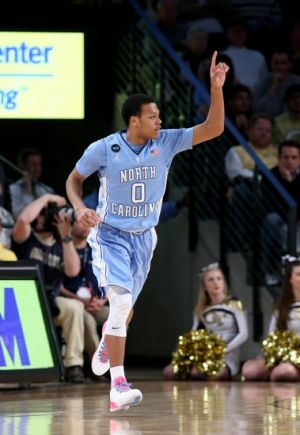 Mar 3, 2015; Atlanta, GA, USA; North Carolina Tar Heels guard Nate Britt (0) celebrates a three-point basket in the second half of their game against the Georgia Tech Yellow Jackets at McCamish Pavilion. The Tar Heels won 81-49. Mandatory Credit: Jason Getz-USA TODAY Sports