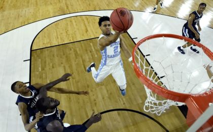 Apr 4, 2016; Houston, TX, USA; North Carolina Tar Heels guard Joel Berry II (2) shoots the ball against Villanova Wildcats forward Daniel Ochefu (23) during the first half in the championship game of the 2016 NCAA Men