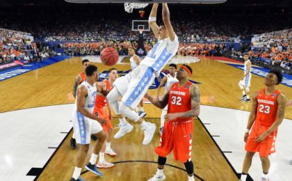 Apr 2, 2016; Houston, TX, USA; North Carolina Tar Heels forward Justin Jackson (44) dunks the ball against Syracuse Orange center DaJuan Coleman (32) during the second half in the 2016 NCAA Men