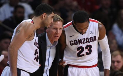 March 7, 2016; Las Vegas, NV, USA; Gonzaga Bulldogs head coach Mark Few (center) instructs guard Josh Perkins (13) and guard Eric McClellan (23) against the BYU Cougars during the second half in the semifinals of the West Coast Conference tournament at Orleans Arena. Mandatory Credit: Kyle Terada-USA TODAY Sports