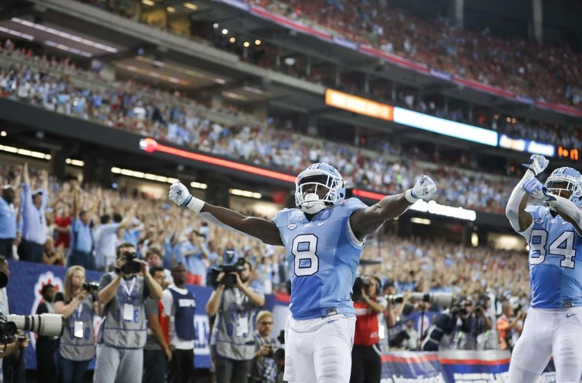 Sep 3, 2016; Atlanta, GA, USA;  North Carolina Tar Heels running back T.J. Logan (8) celebrates after scoring a touchdown against the Georgia Bulldogs during the third quarter of the 2016 Chick-Fil-A Kickoff game at Georgia Dome. Georgia won 33-24. Mandatory Credit: Jason Getz-USA TODAY Sports